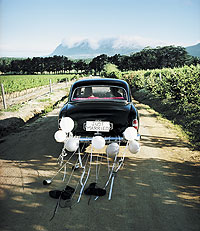 Tying shoes to a wedding car